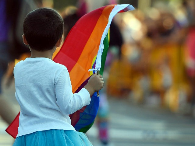 small-child-rainbow-flag-lgbtq-pride-getty-640x480